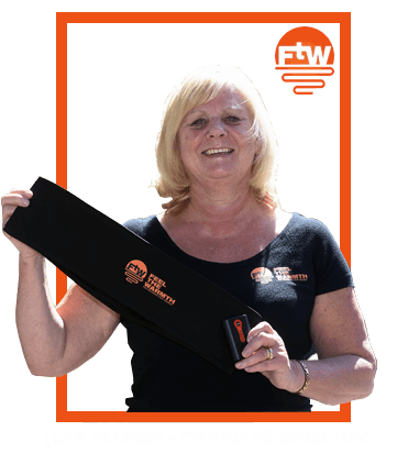 Jean Rooney holds the first generation FTW belt.